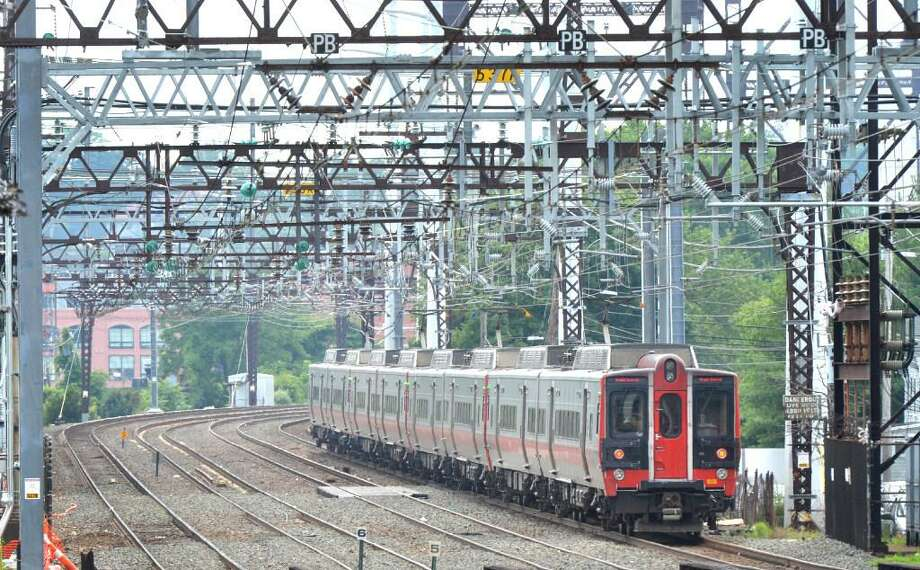 A Metro North train travels through East Norwalk Conn. on Wednesday July 12, 2017. on its way to Grand Central Terminal. Photo: Hearst Connecticut Media File Photo