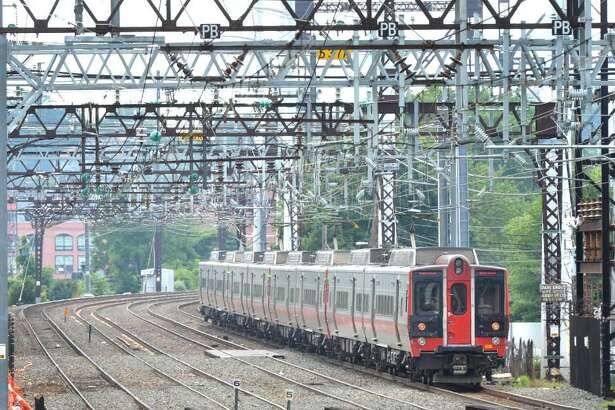 A Metro North train travels through East Norwalk Conn. on Wednesday July 12, 2017. on its way to Grand Central Terminal.