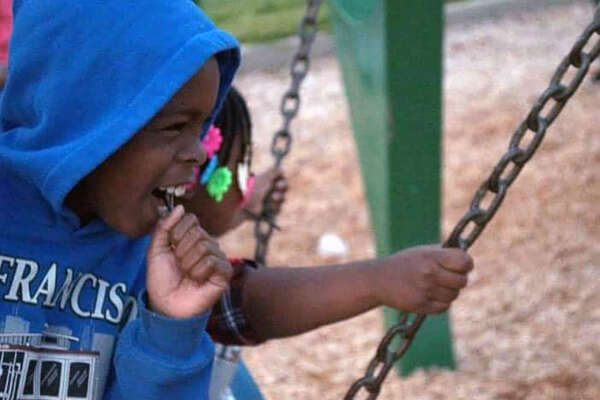 Dante Daniels' family says the 8-year-old died trying to save his younger sister.