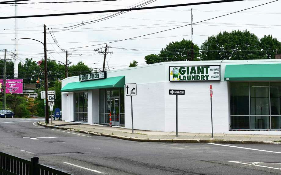 In mid-July 2017, Giant Laundry nears opening at 233 East Ave. in Norwalk, Conn., in space previously occupied by REO Appliance which relocated its showroom into an adjacent storefront. The building was purchased last year by the owner of the Dirty Laundry Laundromat on Main Avenue in Norwalk, with Giant Laundry also having a location in the Bronx. Giant Laundry touts washers that can handle eight times the capacity of conventional machines, also offering dry-cleaning and wash-and-fold services. Photo: Alexander Soule / Hearst Connecticut Media / Stamford Advocate