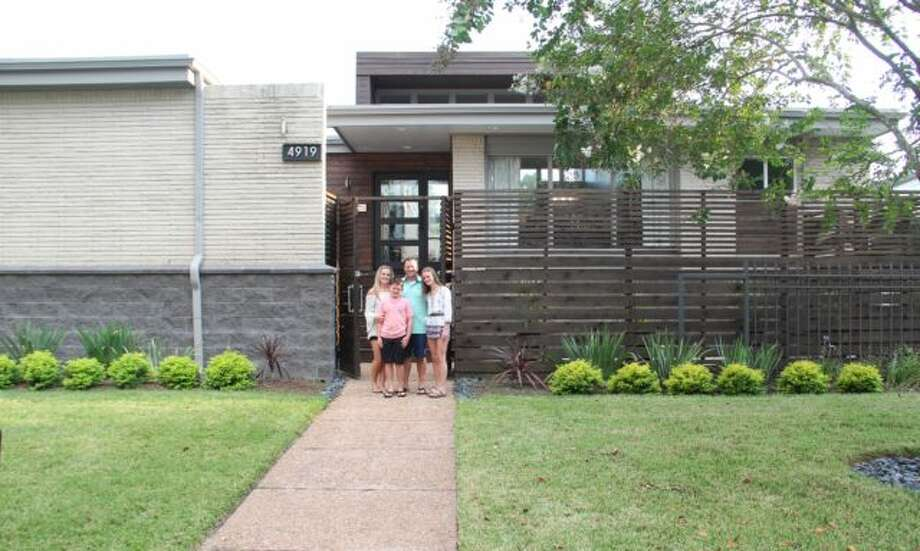The Anders family in front of their elevated house in Meyerland. Photo: Raj Mankad