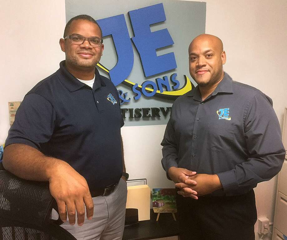 Jonathan Encarnacion, left, and Fabian Encarnacion at the offices of JE & Sons in Danbury. Photo: Chris Bosak / Hearst Connecticut Media / The News-Times