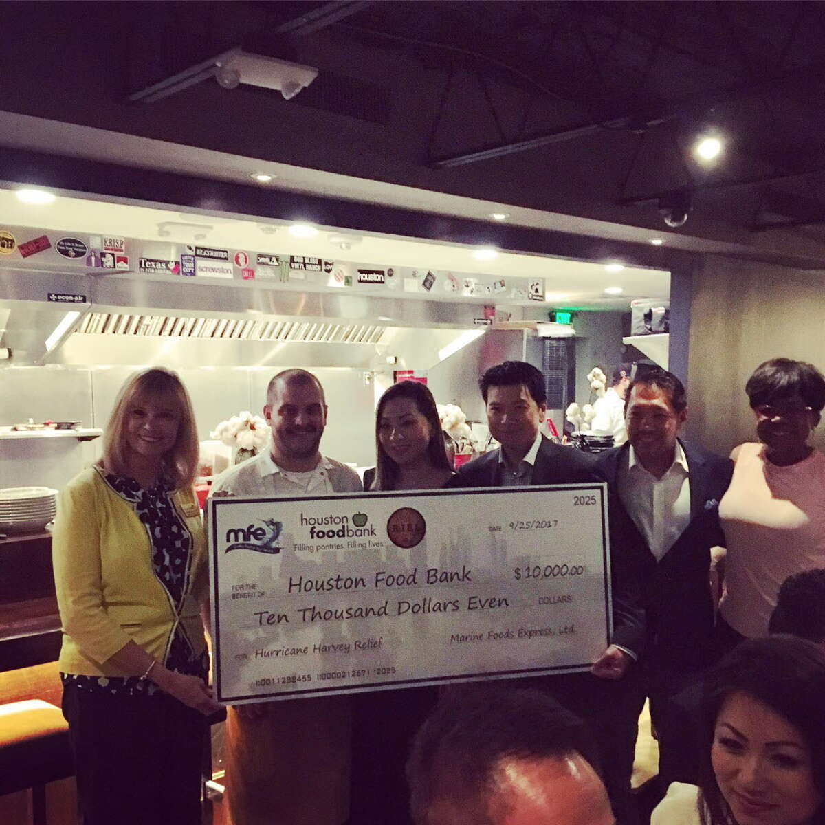 The check presentation at Riel restaurant during the Hurricane Harvey benefit dinner.