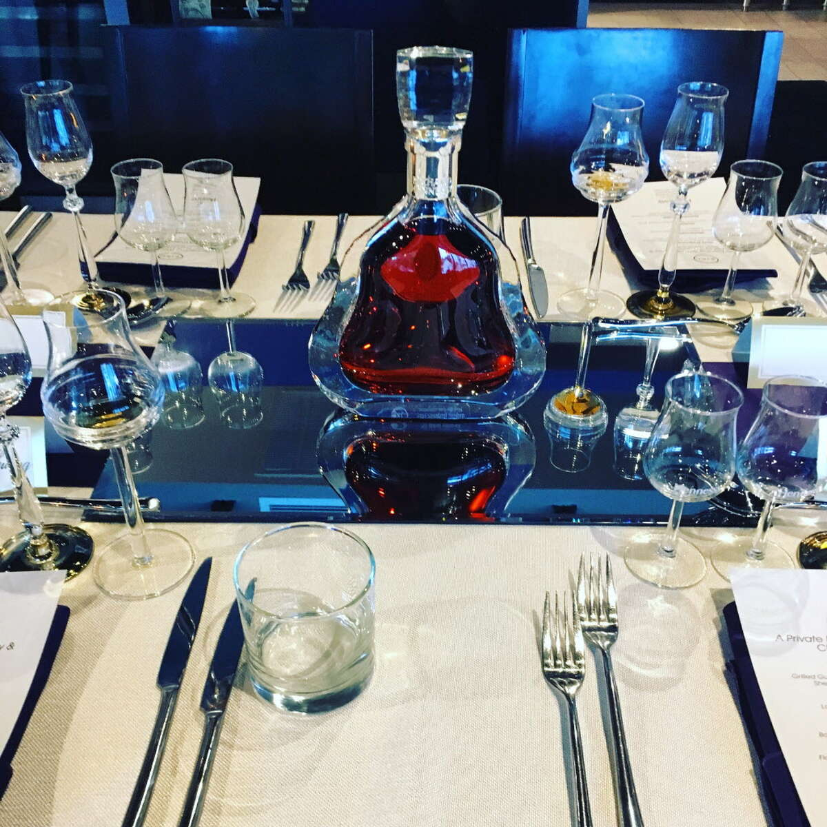 The table settings at Riel restaurant for the Hurricane Harvey benefit dinner in partnership with Hennessy.