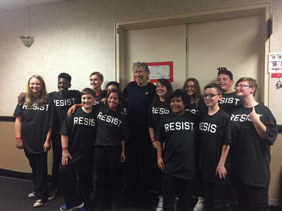 Kids from the Latham School of Rock with Roger Waters, center.