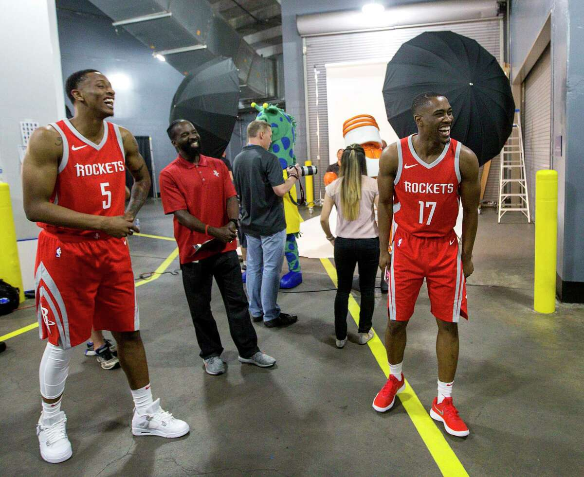 Houston Rockets forward Troy Williams (5) and guard Isaiah Taylor joke with teammate Houston Rockets forward Chinanu Onuaku (21), not pictured, during Houston Rockets media day at the Toyota Center Monday, Sept. 25, 2017, in Houston.