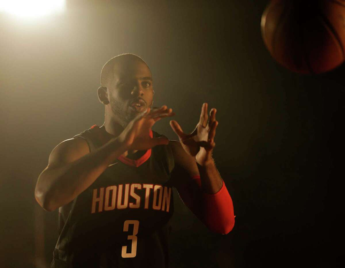 Rocket's Chris Paul (3) films a video during the Houston Rockets media day on Monday, Sept. 25, 2017, in Houston.
