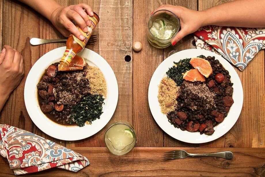Gabi Lustosa shares a meal of feijoada, white rice, farofa, garlicky greens and calpirinha cocktails. Photo: Zach Brothers