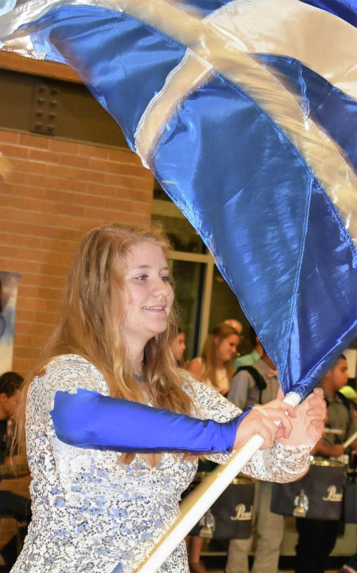 Needville High School Color Guard member Kassidy Hearn performs during last FridayÂ?'s homecoming pep rally.