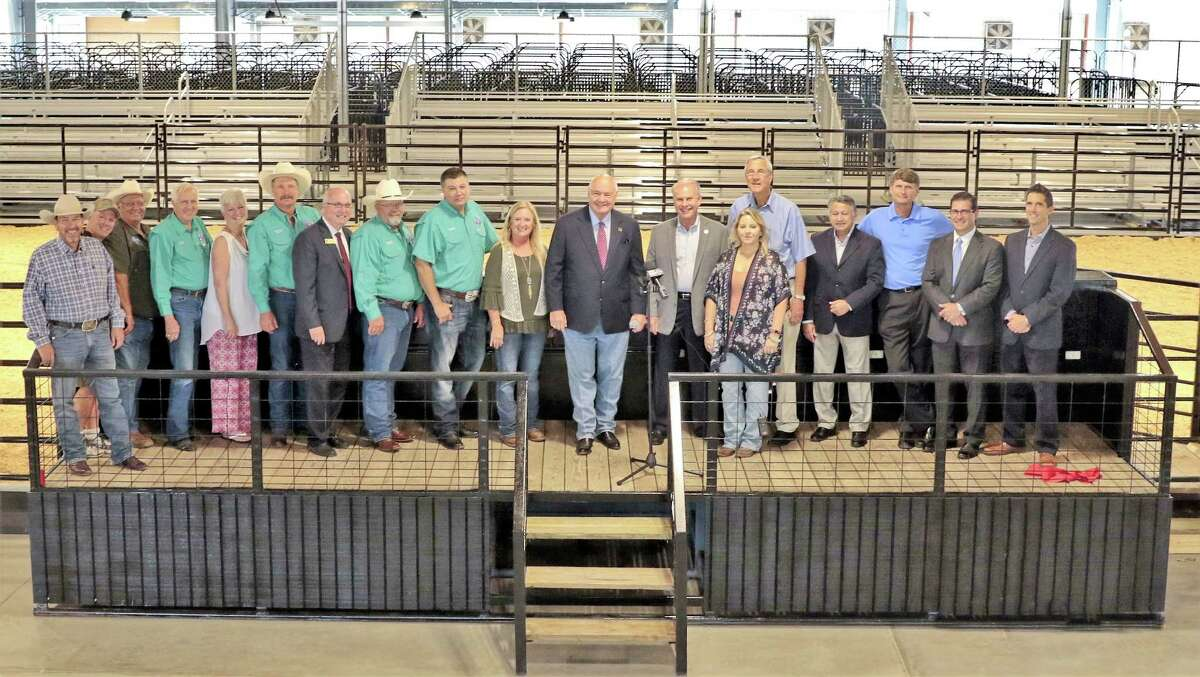 Fort Bend County Officials and Fair Association Board Directors gathered Sept. 21 to celebrate the Grand Opening of the Fort Bend County Fairgrounds' newly completed George Pavilion, previously George Livestock Barn. From left are: Fort Bend County Fair Association Board Directors: Neil Yelderman, Sean Gutierrez, Calvin Zwahr, Cecil Willis, Marjie Pollard, Bobby Poncik, James Duke, Brian Graeber, Ernest Lawson, and Cindy Schmidt; Fort Bend County Judge, Bob Hebert; Commissioner Precinct 1, Vincent Morales; Fairgrounds Manager Mary Staff; Commissioner Precinct 4, James Patterson; Abe Sustaita, Sustaita Architects; Fort Bend County Facilities Director Jamie Knight; Brad Crain, Crain Group; John Green, Crain Group