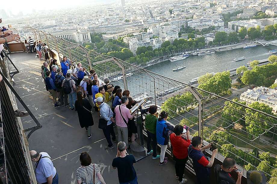 Paris views are better from the tower's second level than its very top, as you're closer to the city's rooftops. Photo: Cathy Lu, Rick Steves' Europe