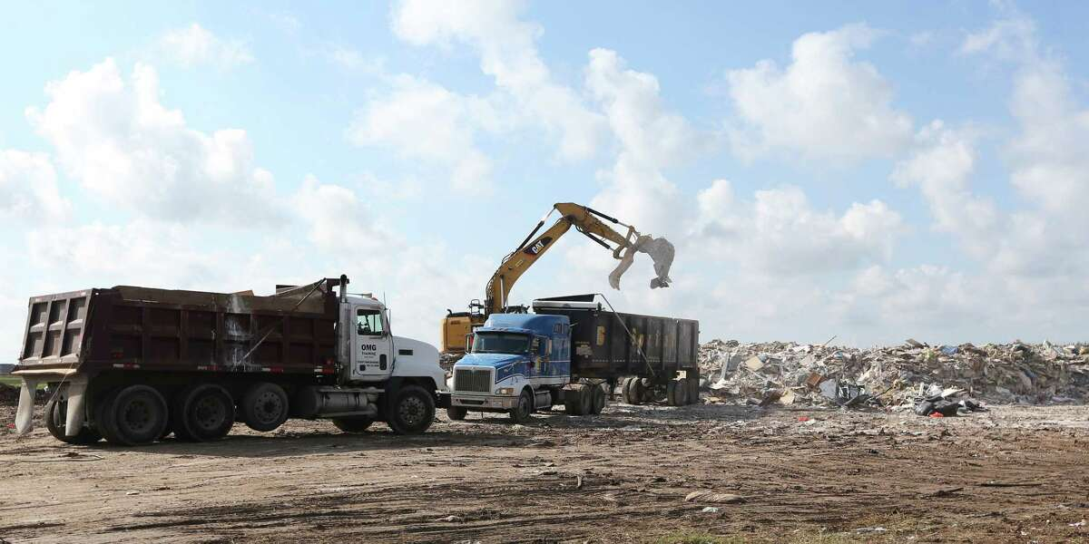 A large debris field near the corner of Beechnut and S. Mason in Richmond. One of the MUD (municipal utility districts) has set up a dumping area on an open lot Friday, Sept. 22, 2017, in Richmond. ( Steve Gonzales / Houston Chronicle )