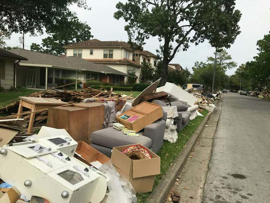 Residents of Bellaire neighborhoods are slowly getting back to normal despite mountains of debris strewn on laws throughout the community. Photo: Jaimy Jones / Houston Chronicle