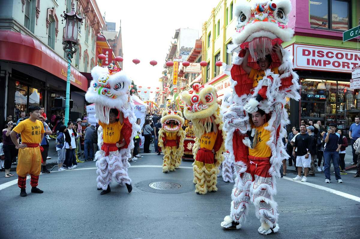 Members of Yau Gum Moon Lion Dance Troupe perform during Chinatown's Autumn Moon festival, which opened Saturday September 10, 2011 and runs through tomorrow.