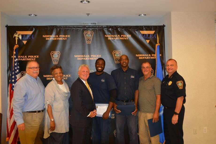 The Norwalk Police Commission recognized three Norwalk Housing Authority employees with Civilian Awards for Community Service. Housing Authority employees Peter Agosto, Arnold Fuller and Devon Moore were all recognized for their actions during a fire in building 20 at Roodner Court. Pictured from left to right are Commissioner Yost, Commissioner Collier-Clemmons, Mayor Harry W. Rilling, Moore, Fuller, Agosto and Chief Thomas Kulhawik Photo: Contributed Photo / Norwalk Police Department