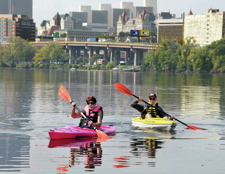 Kayakers Betty McMillan and Jerry Ryan of Rensselaer paddle the Hudson River under the backdrop of the Albany skyline Tuesday Sept. 26, 2017 in Rensselaer, NY.  (John Carl D'Annibale / Times Union) Photo: John Carl D'Annibale, Albany Times Union / 40041682A
