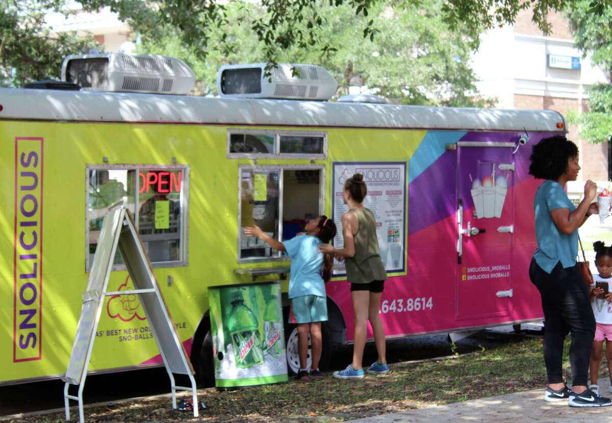 People enjoy Snolicious snow cones during A Taste of Lake Houston Festival at Town Center Park in Kingwood on Saturday, Sept. 23.