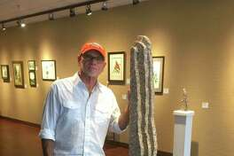 """G. Scott McCarley, who will partner with Hutch Hutcheson in the two-man show """"Reunion"""" Oct. 16-27 at the Lowman Student Art Gallery, Sam Houston State University, standing next to his granite sculpture titled """"Pieces of You,"""" a tribute to iconic Texas sculptor Jesus Moroles."""