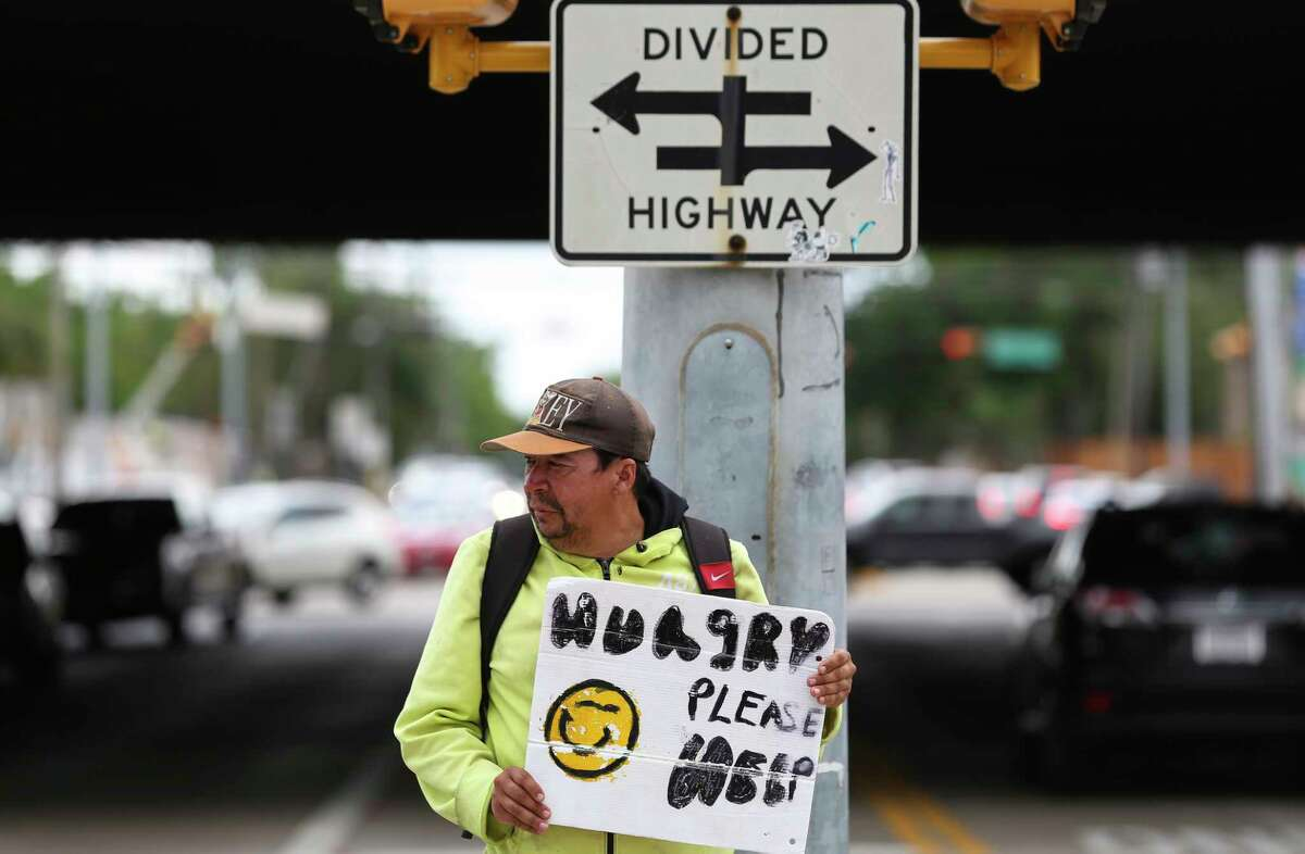 Andrew Quintanilla stands on the medium and panhandles from traffic at the intersection of Southwest Freeway and Weslayan Street Friday, April 14, 2017, in Houston. ( Yi-Chin Lee / Houston Chronicle )
