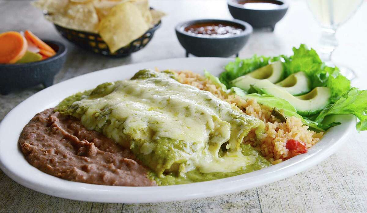 Enchiladas a la Michael (chicken enchiladas smothered in salsa verde) at Molina's Cantina. Molina's, Houston's oldest family-owned and operated Tex-Mex restaurant, is marking its 75th anniversary in 2016. Molina's announced it will close its 4720 Washington sore on Sept. 30.