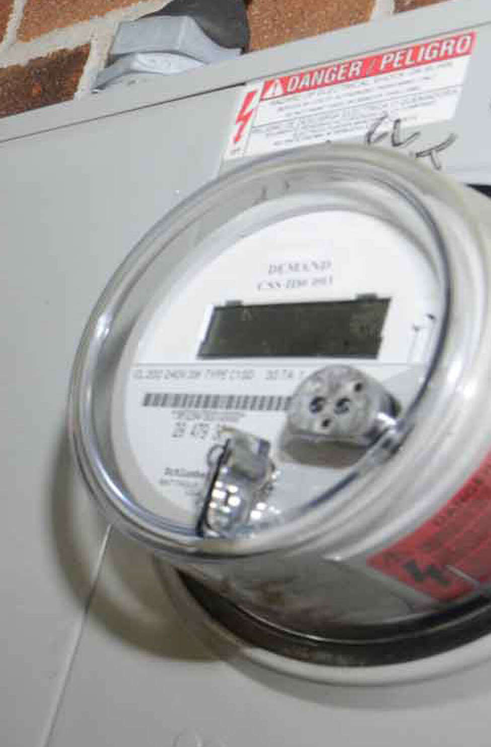 Michael Connelly, exec. dir, Northeast Associates in Rehabilitation shows the electric meters that have been being attributed to the wrong end user in Colonie on Tuesday 9/21/2010.( Michael P. Farrell / Times Union ) ORG XMIT: MER2017092612251803
