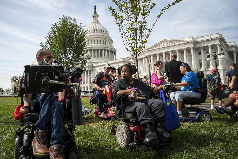 WASHINGTON, DC - SEPTEMBER 26: People in wheelchairs, from the group ADAPT, wait for senators to arrive for a news conference in opposition to the Graham-Cassidy health care bill, September 26, 2017 in Washington, DC. The Graham-Cassidy bill, the GOP's latest effort to repeal the Affordable Care Act (ACA), is in peril after Sen. Susan Collins (R-ME) announced her opposition to the bill on Monday night. (Photo by Drew Angerer/Getty Images) Photo: Drew Angerer, Getty Images