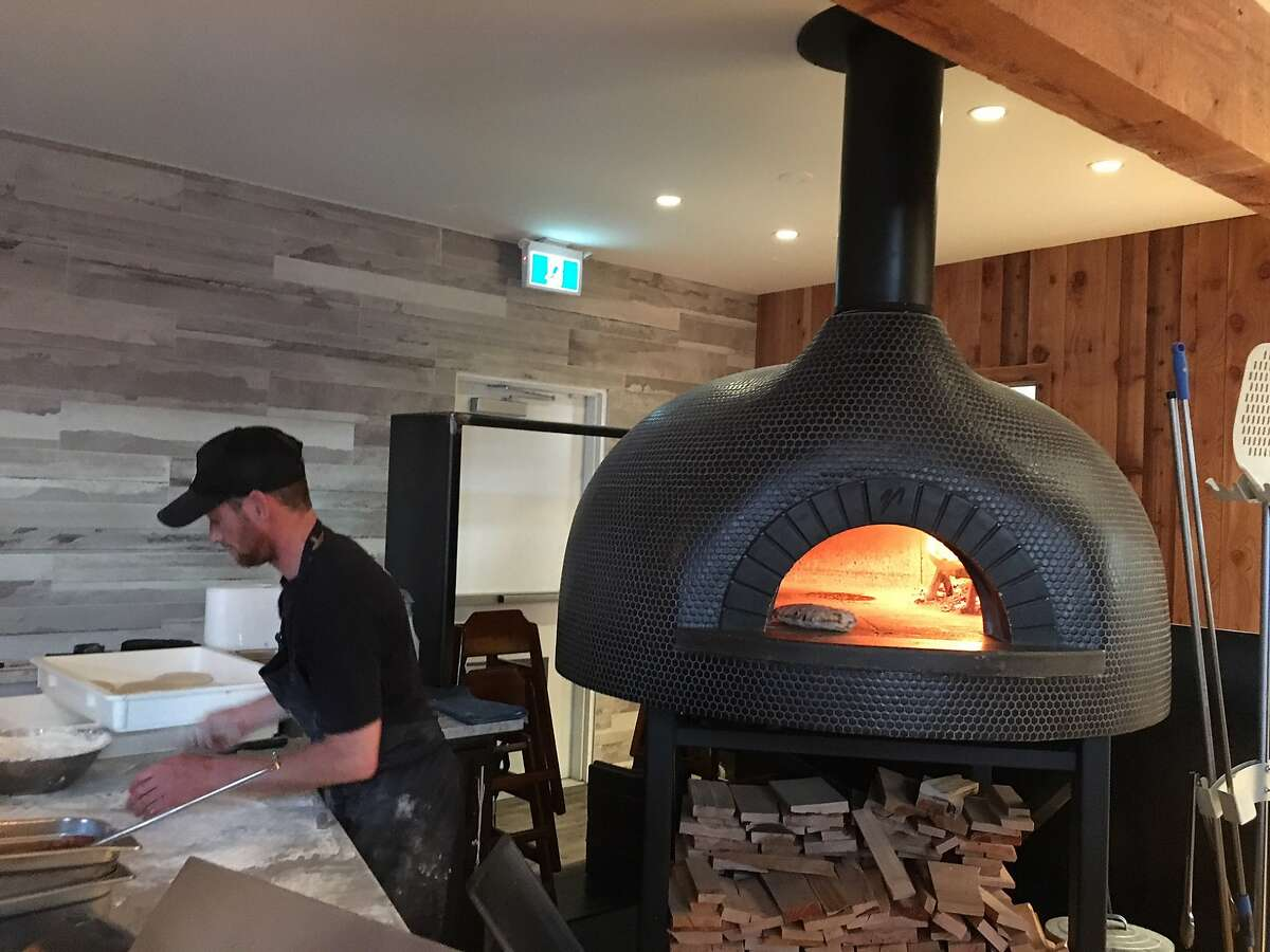 The wood-burning oven at Tofino Resort & Marina turns out pizzas for both restaurants at the remodeled hotel and docks on the ocean side of Vancouver Island, British Columbia.