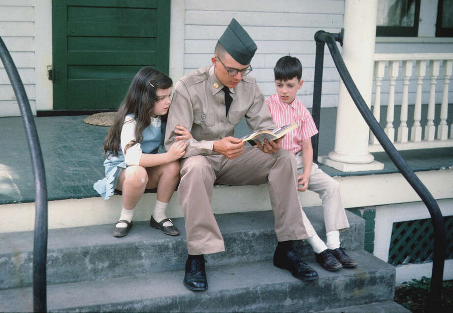 """Denton """"Mogie"""" Crocker of Saratoga Springs on the porch of his family's home in 1965, before his departure for Vietnam. He sits with his sister Candy and brother Randy. He died in combat the following year. (PBS/The Crocker Family) Photo: Crocker"""