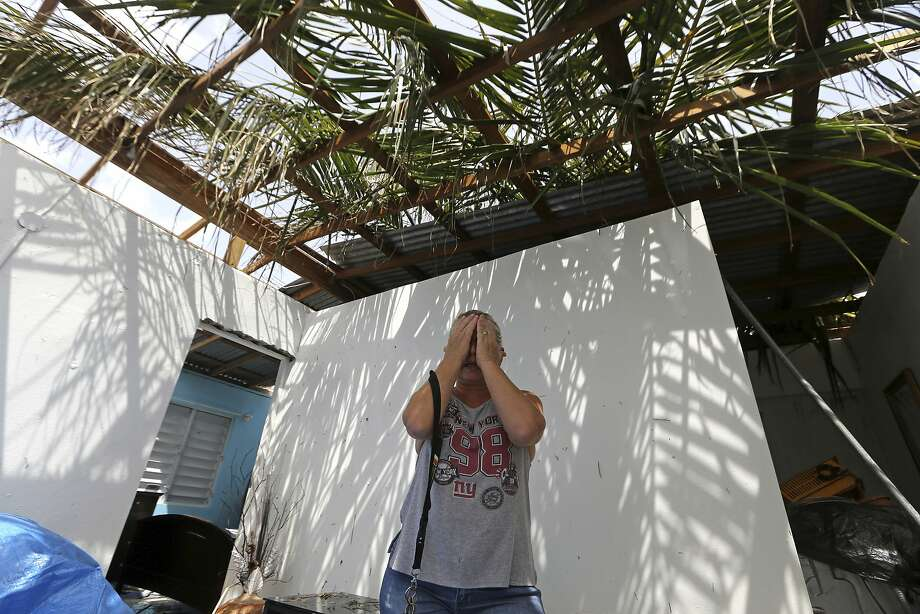 Nelida Trinidad talks about the destruction of her home in Montebello, Puerto Rico, in the aftermath of Hurricane Maria, Tuesday, Sept. 26, 2017. Five days after the Category 4 storm slammed into Puerto Rico, many of the more than 3.4 million U.S. citizens in the territory were still without adequate food, water and fuel. Flights off the island were infrequent, communications were spotty and roads were clogged with debris. Officials said electrical power may not be fully restored for more than a month. (AP Photo/Gerald Herbert) Photo: Gerald Herbert, Associated Press