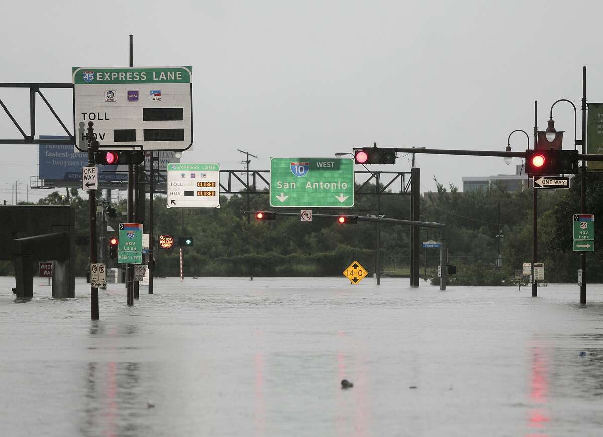 Louisiana Street is flooded where it becomes I-10 in downtown Houston as Hurricane Harvey inches its way through the area on Sunday, Aug. 27, 2017.