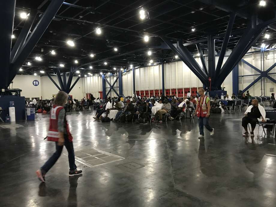 People seeking shelter from Hurricane Harvey at the George R. Brown Convention Center on Sunday, August 27, 2017. (Elizabeth Conley/Houston Chronicle) Photo: Elizabeth Conley