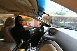 """TO GO WITH AFP STORY BY ACIL TABBARA  Saudi activist Manal Al Sharif, who now lives in Dubai, drives her car in the Gulf Emirate city on October 22, 2013, as she campagins in solidarity with Saudi women preparing to take to the wheel on October 26, defying the Saudi authorities, fight for women's right to drive in Saudi Arabia. Under the slogan """" driving is a choice """", activists have called on social networks for women to gather in vehicles on October 26, the culmination of the campaign launched in September, in the only country in the world where women do not have the right drive."""