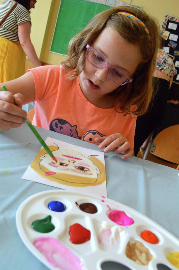 Anora Voss, 8, of Darien, adds detail to her self portrait at the Frida Friday art class in honor of Hispanic Heritage Month at the Darien Library, Friday, Sept. 22, 2017, in Darien, Conn. Photo: Jarret Liotta / For Hearst Connecticut Media / Darien News Freelance
