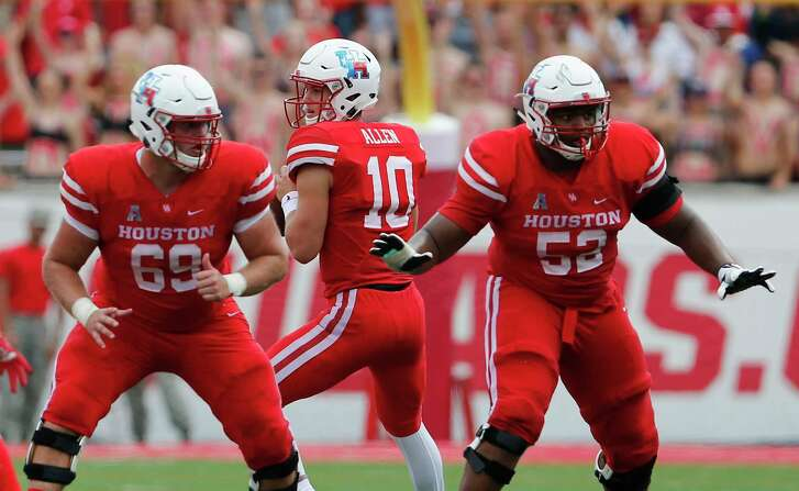 Houston Cougars offensive lineman Will Noble (69) and offensive lineman Braylon Jones (52)  block as Kyle Allen (10) looks to pass during the NCAA football game between the Texas Tech Red Raiders and the Houston Cougars at TDECU Stadium in Houston, TX on Saturday, September 23, 2017.