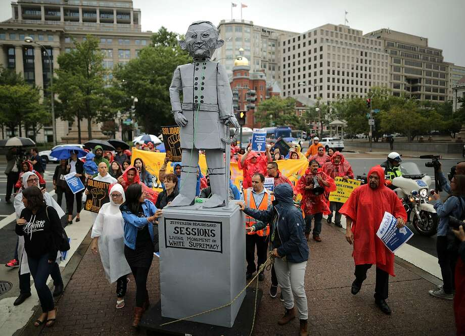 WASHINGTON, DC - SEPTEMBER 06:  Protesters march with a mock statue of Attorney General Jeff Sessions as they head to the Department of Justice to demonstrate against the Trump Administration's decision to end the 2012 Deferred Action for Childhood Arrivals (DACA) policy September 6, 2017 in Washington, DC. The protest was organized by Mijente, the Georgia Latino Alliance for Human Rights, Juntos, Organized Communities Against Deportations and United We Dream. Attorney General Jeff Sessions blamed DACA, an Obama-era program which shielded about 800,000 immigrants who illegally arrived in the United States as children, for an increase in unauthorized immigration and for taking jobs away from Americans.  (Photo by Chip Somodevilla/Getty Images) Photo: Chip Somodevilla, Getty Images