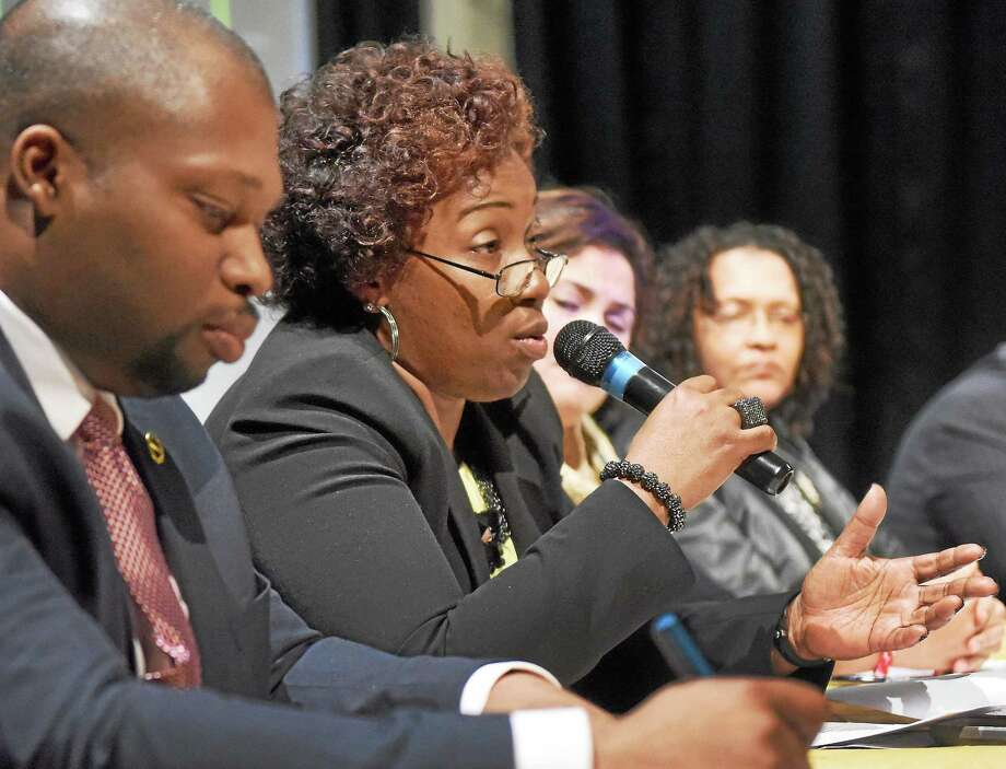 """(Peter Hvizdak - New Haven Register) ¬ State Senator Gary Holder-Winfield, left, and State Representative Robyn Porter, second from left, during a panel discussion on """"Social Justice in a PostMichael Brown Era"""" with political, religious, social and professional leaders of the New Haven area community during the Partners for Progress 18th Annual Sigma Gamma Rho Sorority, Inc. YouthSymposium at Hill Regional Career Magnet School in New Haven Saturday, March 14, 2015 sponsored by the Iota Chi Sigma Chapter of the Sigma Gamma Rho Sorority. Photo: Peter Hvizdak / ©2015 Peter Hvizdak / ©2015 Peter Hvizdak"""