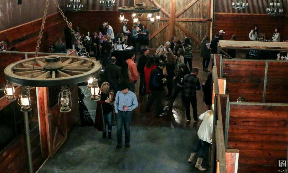 Guests from last year's Wildcatters Ball are seen in the refurbished stables at the Rolling 7s Ranch Event Center in Odessa. The annual event for the benefit of Big Brother Big Sisters is planned for Oct. 7.  Photo: COURTESY PHOTO