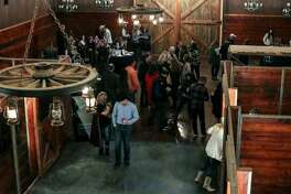 Guests from last year's Wildcatters Ball are seen in the refurbished stables at the Rolling 7s Ranch Event Center in Odessa. The annual event for the benefit of Big Brother Big Sisters is planned for Oct. 7.