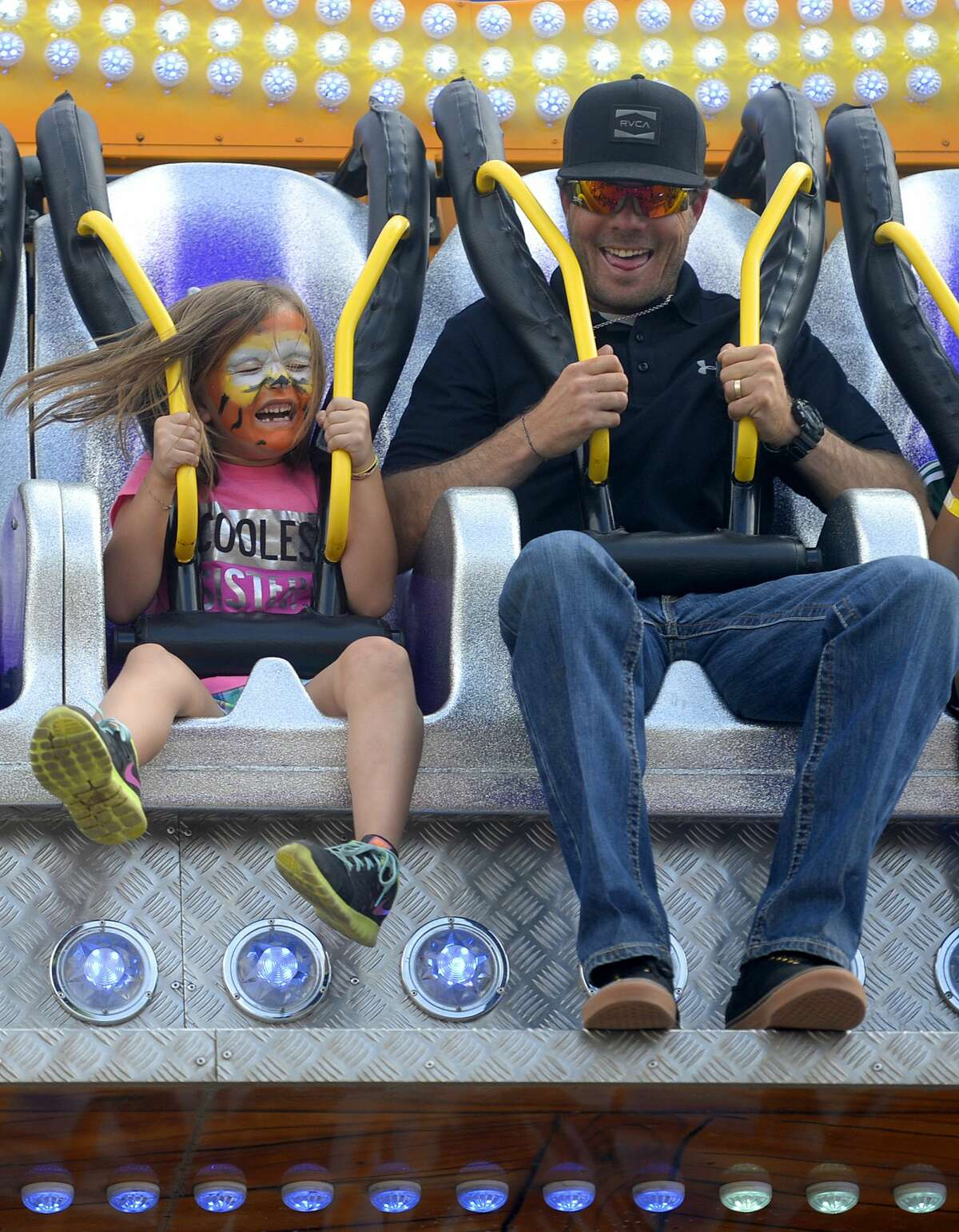 Ledger Brown rides the Riptide with her father, Jarrod Brown, at the St. Ann's Family Fair in this 2016 photo.