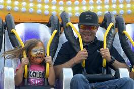 Ledger Brown rides the Riptide with her father, Jarrod Brown, at the St. Ann's Family Fair Sept. 24, 2016. This year's fair is Sept. 30.