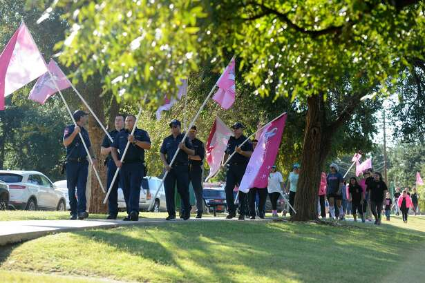 Members of the Midland Fire Department walk during last year's Pink the Park, an annual event at Grafa Park that pays tribute to those with breast cancer.
