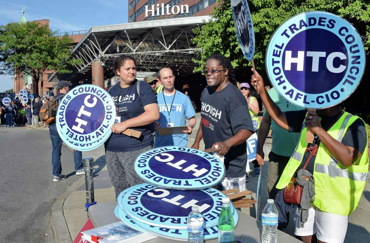 Unionized hotel workers pick up signs to picket at the Albany Hilton Hotel to protest the lack of a new contract with the hotel owner Tuesday Sept. 26, 2017 in Albany, NY. (John Carl D'Annibale / Times Union)
