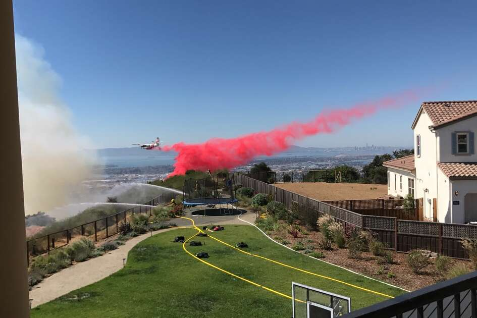 Oakland resident Renato posted this photo from his backyard of the Oakland Hills fire showing planes dumping fire retardant onto the hillside.