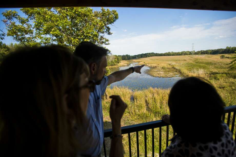 People check out the view from an observation tower that was recently installed on the Chippewa Nature Center's Wetlands property located on Badour Road between Pine River and Ashby during a ribbon cutting ceremony on Tuesday, Sept. 26, 2017. (Katy Kildee/kkildee@mdn.net) Photo: (Katy Kildee/kkildee@mdn.net)