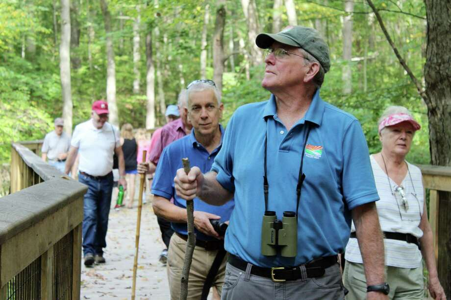 Norwalk River Valley Trail Executive Director Charlie Taney leads a Stay at Home Wilton's first bird walk for seniors and guests on Sept. 21, 2017. Photo: Stephanie Kim / Hearst Connecticut Media