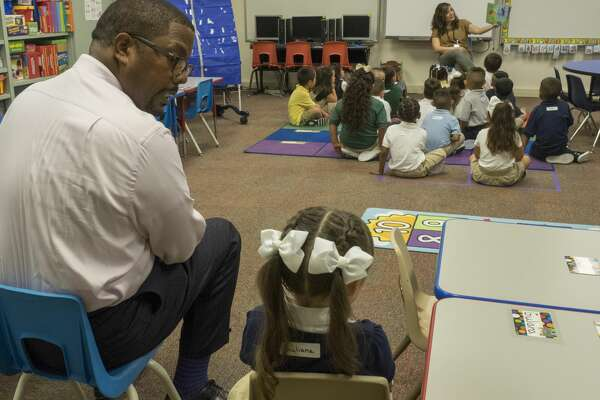 Midland ISD Superintendent Orlando Riddick sits with a South Elementary School pre-k student who was a little shy about joining her classmates on the first day of school.