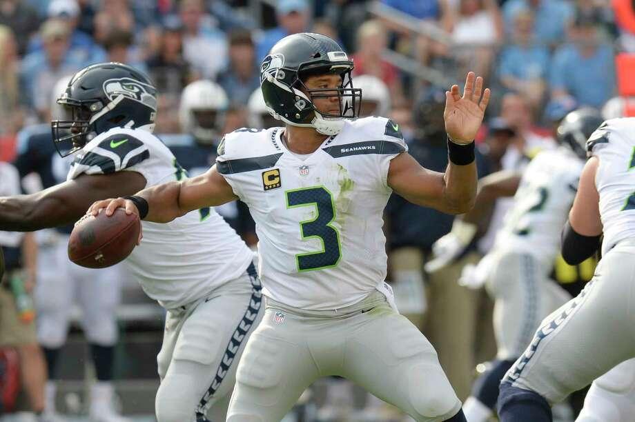 Seattle Seahawks quarterback Russell Wilson (3) passes against the Tennessee Titans in the first half of an NFL football game Sunday, Sept. 24, 2017, in Nashville, Tenn. (AP Photo/Mark Zaleski) Photo: Mark Zaleski, Associated Press / FR170793 AP