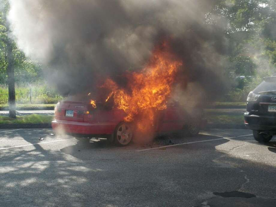 The Westport Fire Department quickly extinguished a car fire at Parker Harding Plaza in Westport at approximately 5:50 p.m. on Wednesday, June 23, 2010. No injuries were reported. Photo: Contributed Photo / Westport News