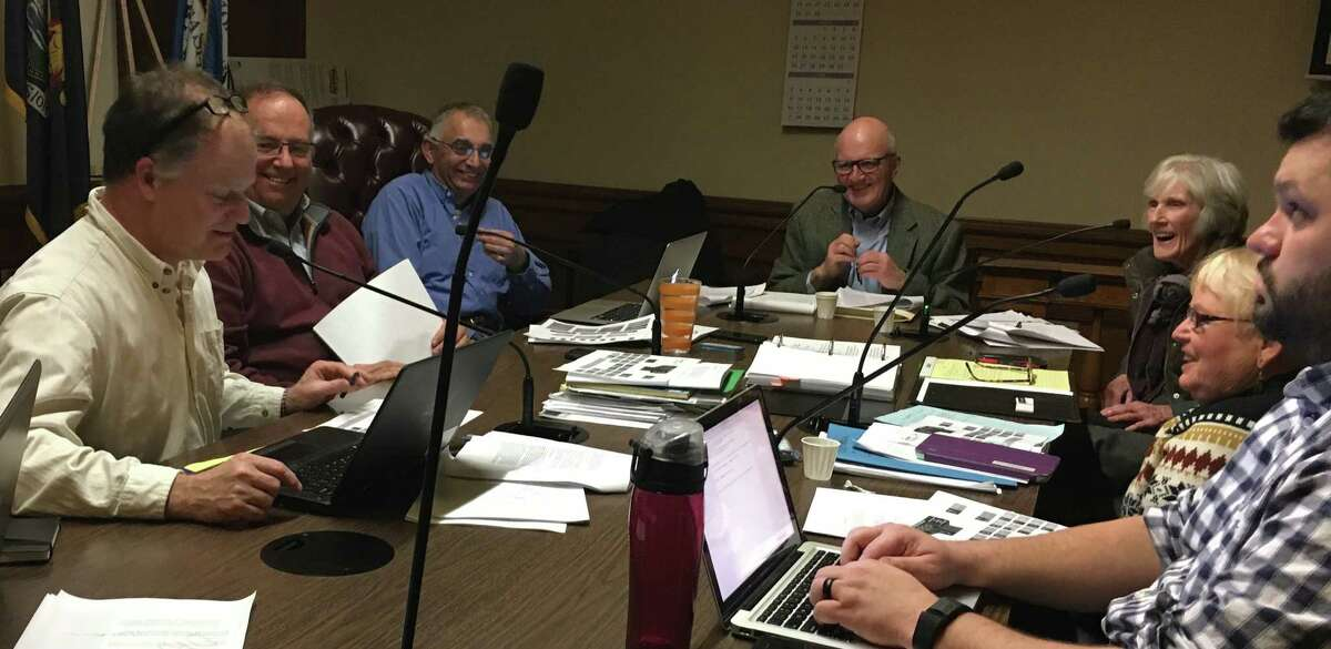 Bob Batson, center, speaks with members of Saratoga Springs charter commission.Two commissioners on the City Council have decided to stand in the way of disseminating the Charter Commission's report. Bob Turner, chair of the 2017 charter review commission, sits at the far left. (Times Union archive)