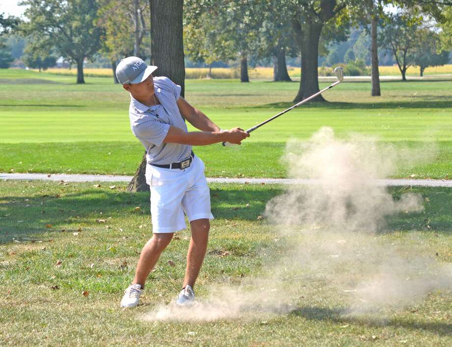 Edwardsville senior Ben Tyrrell watches the flight of his ball after making his second shot on hole No. 9 at Belk Park Golf Course in Wood River on Tuesday during the Southwestern Conference tournament.